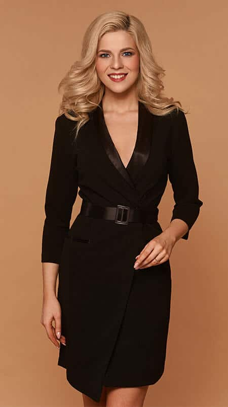 blond young woman wearing a business dinner black dress