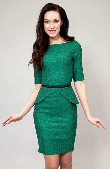 woman wearing a green mid-length dress