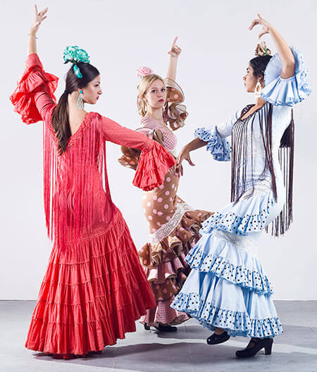 spanish women wearing flamenco dresses