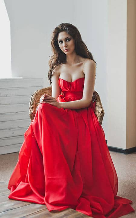 woman wearing a red gown