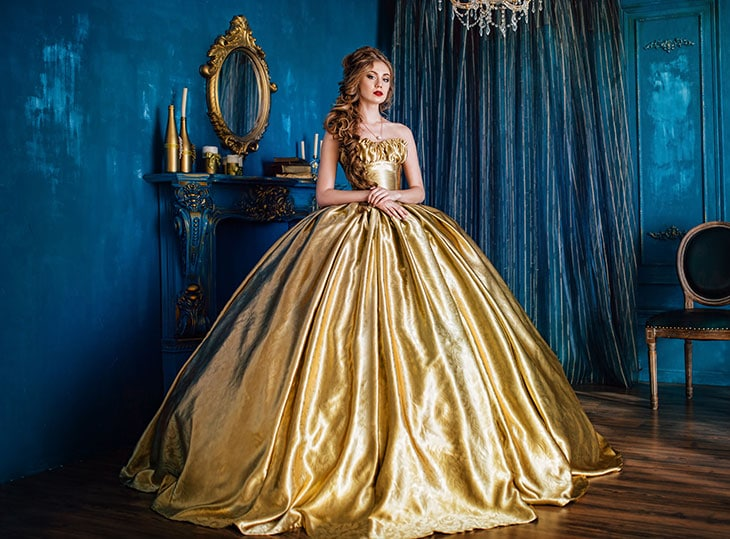 woman wearing a golden formal dress for a ball gown
