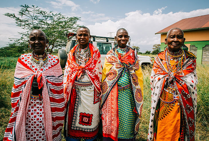 african men wearing kangas