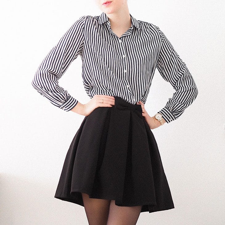 woman wearing black skirt with pleats