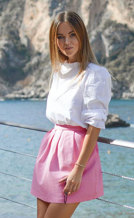 young woman wearing a pink skirt