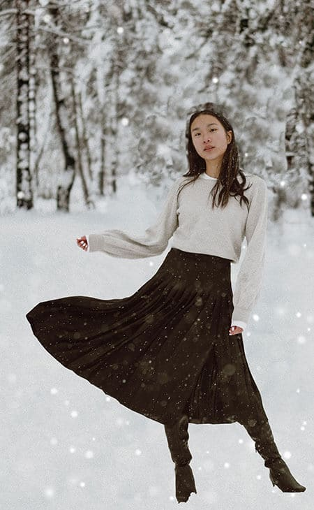 young woman wearing a gored skirt in the snow