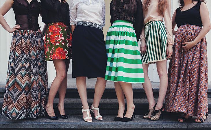 different women wearing skirts