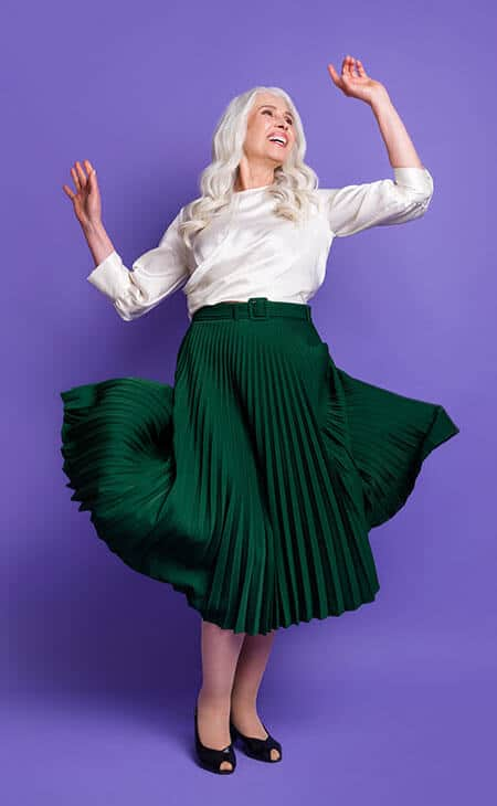 mature happy woman in green midi skirt