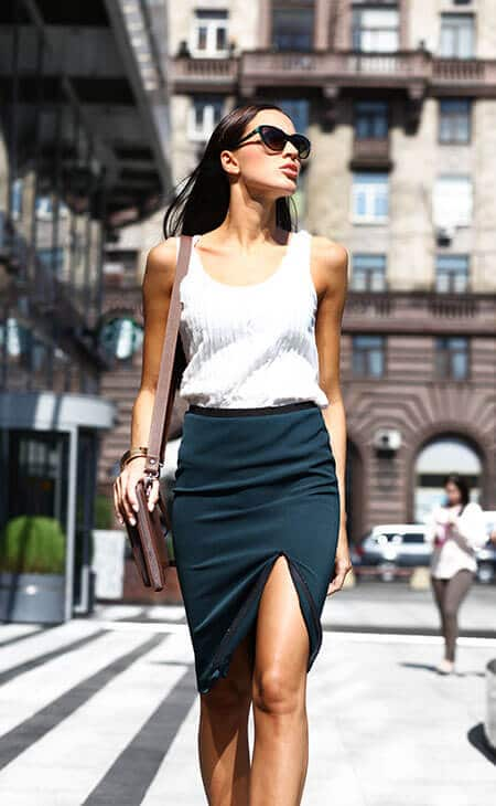 woman walking on the street wearing a pencil skirt