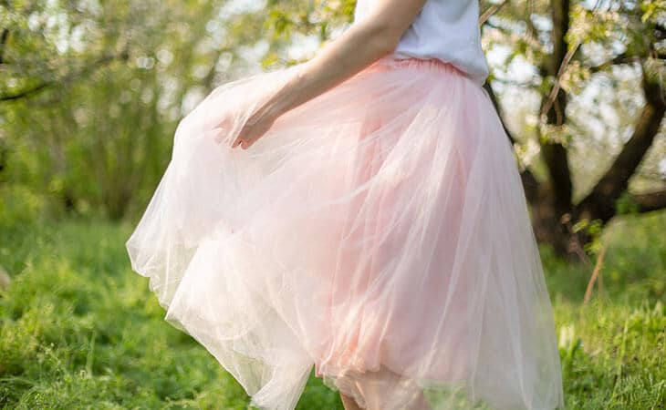 woman wearing a tutu skirt in the woods