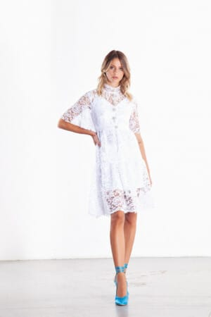 Turtleneck Short white dress covered by lace