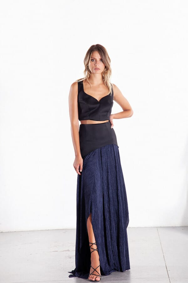 black halter top with long black and blue skirt