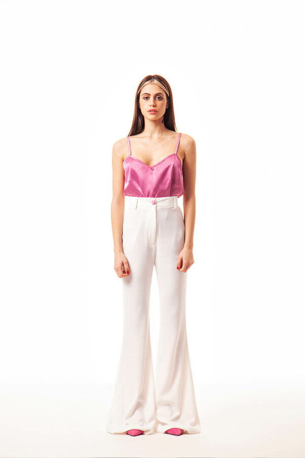 high-waisted white pants with flared leg